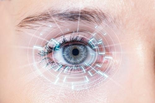 Close-up of woman's blue eye. High Technologies